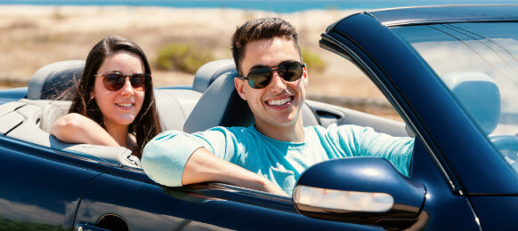 couple inside a blue car rental in penrose