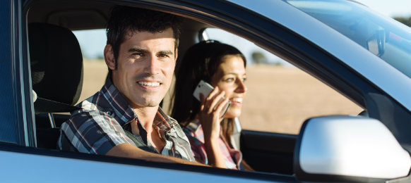 couple inside their blue car rental