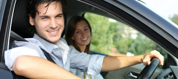 couple smiling inside their rental car in wanganui