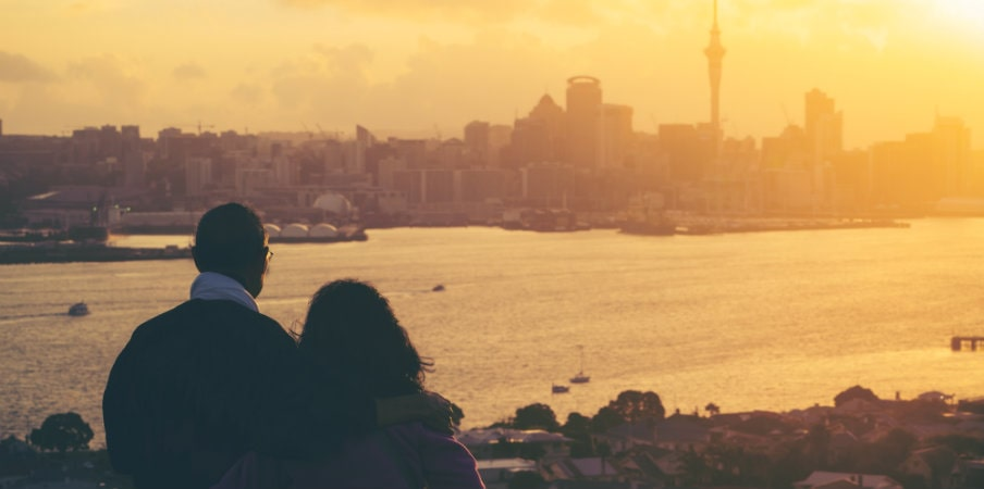 happy couple watching sunset auckland