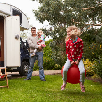 happy family and a campervan