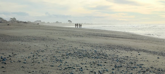 People Walking on Hokitika Beach, New Zealand