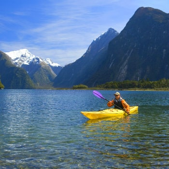 man kayaking in milford sound