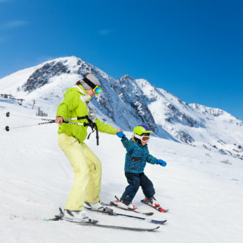 Mother and son skiing together at Tongariro National Park