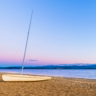 sail boat on a beach of Lake Taupo