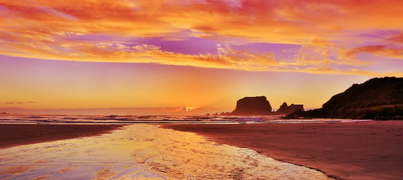 Sandy beach at Sunset in Westport of New Zealand