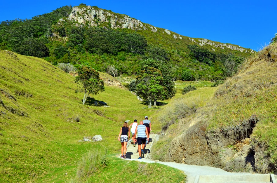 Tourists hike to the top of Mount Maunganui, NZ