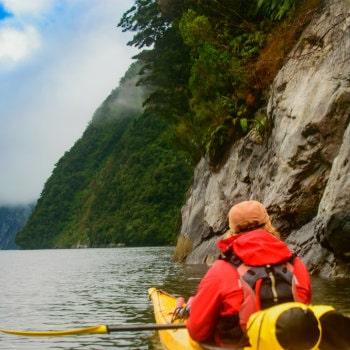woman kayaking in milford sound